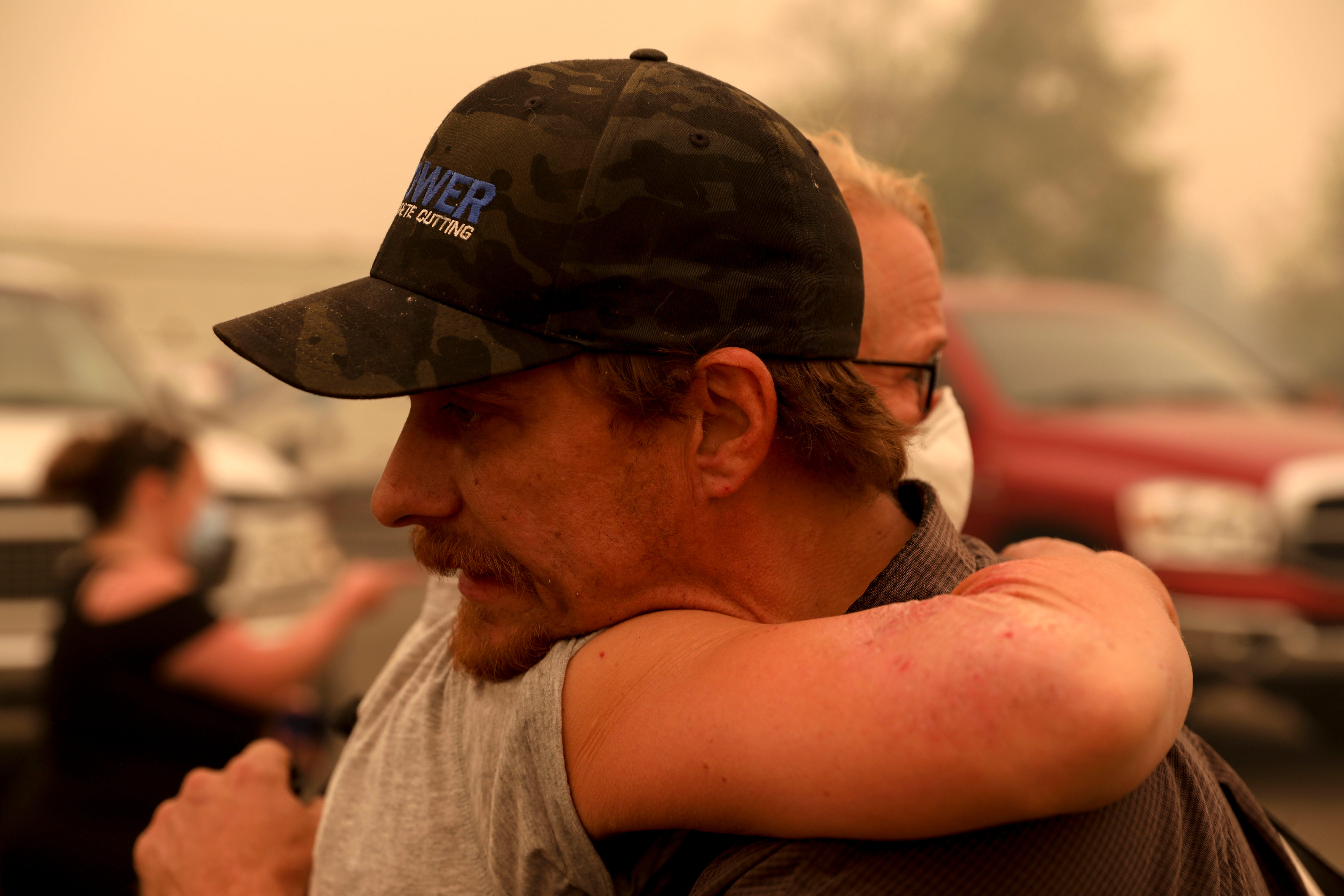 Chris Tofte hugs a friend before a group leaves to search for his son Wyatt Tofte, 13, and his dog Duke in Stayton, Oregon on Wednesday, Sept. 9, 2020.