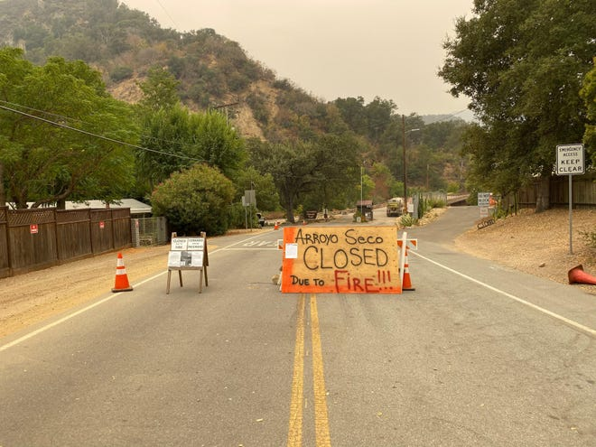 Signs blocking the entrance to Arroyo Seco due to the Dolan Fire. Sept. 9, 2020.