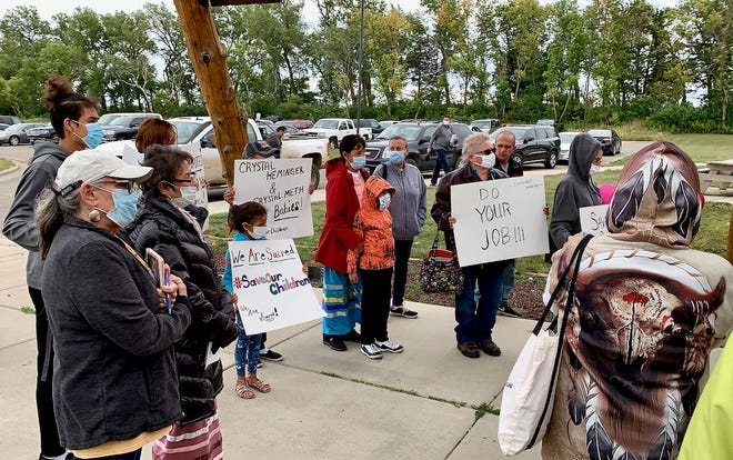 Protesters from the Sisseton Wahpeton Oyate protest outside the tribe's administrative building Tuesday.