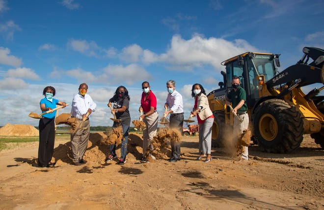 Local elected officials and a representative from the Thomas P. Smith Water Reclamation facility break ground on the new water quality laboratory Thursday, Sept. 10, 2020.