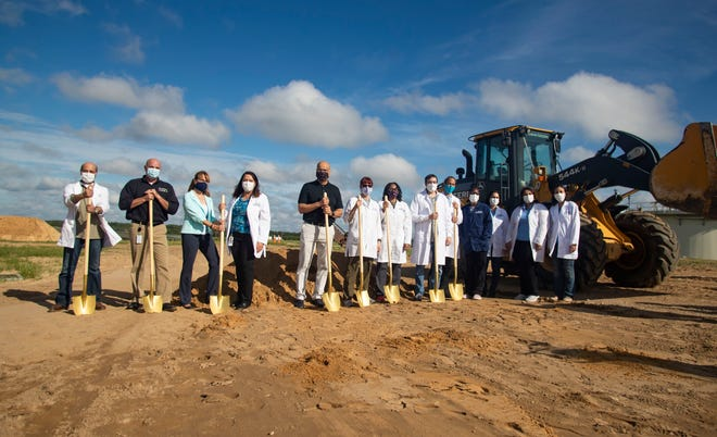 Representatives from the Thomas P. Smith Water Reclamation facility pose for a photo during the ground breaking ceremony for the new water quality laboratory Thursday, Sept. 10, 2020.