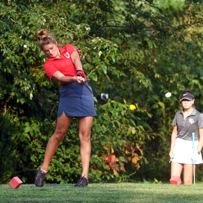 Sheridan's Shauna White hits her drive on the eighth hole on Wednesday at Coyote Run. Sheridan hosted River View and Tri-Valley in a Muskingum Valley League trimatch.