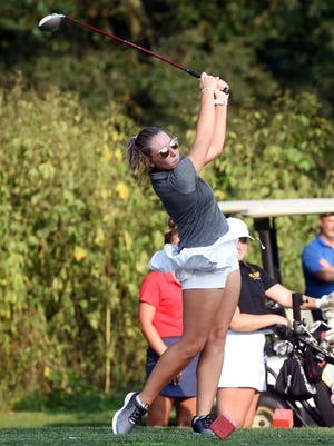 Madalyn Cutshall tees off for River View during a trimatch with host Sheridan and River View on Wednesday at Coyote Run.