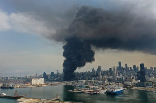 Black smoke rises from a fire at warehouses at the seaport in Beirut, Lebanon, Thursday, Sept. 10. 2020. A huge fire broke out Thursday at the Port of Beirut, triggering panic among residents traumatized by last month's massive explosion that killed and injured thousands of people.