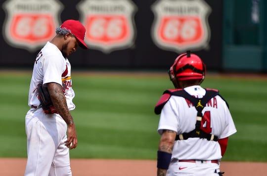St. Louis pitcher Carlos Martinez and catcher Yadier Molina.