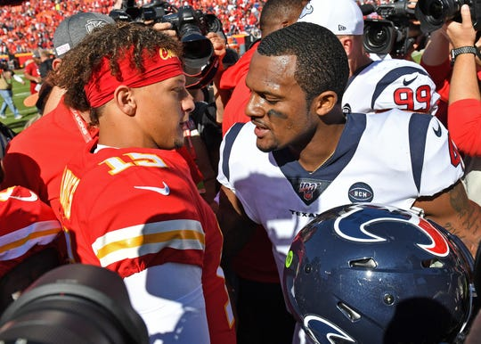 Quarterback Deshaun Watson #4 of the Houston Texans talks with quarterback Patrick Mahomes #15 of the Kansas City Chiefs after beating the Chiefs at Arrowhead Stadium.