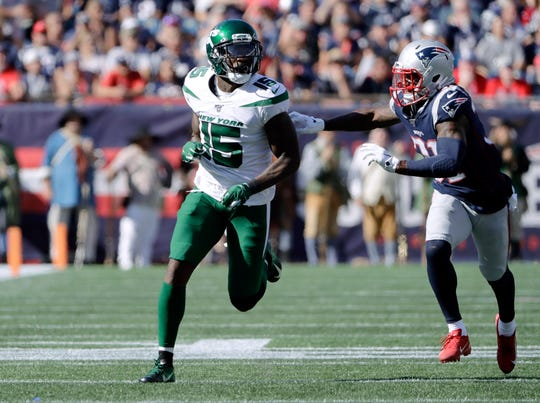In this Sunday, Sept. 22, 2019 file photo, New York Jets wide receiver Josh Bellamy runs a pass route as New England Patriots defensive back Jonathan Jones (31) gives chase in the second half of an NFL football game in Foxborough, Mass.