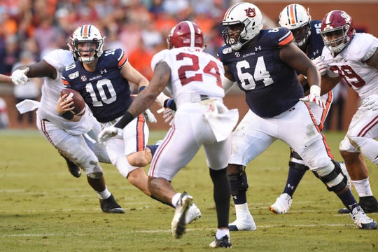 Auburn quarterback Bo Nix runs the ball against Alabama during their 2019 game at Jordan-Hare Stadium.
