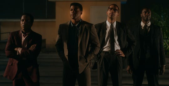 "Leslie Odom Jr. (far left) stars as Sam Cooke, Eli Goree plays Cassius Clay, Kingsley Ben-Adir is Malcolm X and Aldis Hodge is Jim Brown in Regina King's feature directorial debut ""One Night in Miami."""