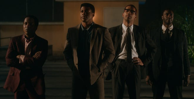 """Leslie Odom Jr. (from  left) stars as Sam Cooke, Eli Goree plays Cassius Clay, Kingsley Ben-Adir is Malcolm X and Aldis Hodge is Jim Brown in Regina King's feature directorial debut """"One Night in Miami."""""""