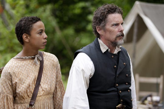 """Joshua Caleb Johnson as Henry and Ethan Hawke as abolitionist John Brown in Showtime miniseries """"The Good Lord Bird."""""""