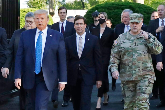 """President Donald Trump walks across Lafayette Park across from the White House to visit St. John's Church after the area had been cleared of protesters. Walking behind Trump from left are, Attorney General William Barr, Secretary of Defense Mark Esper and Gen. Mark Milley, chairman of the Joint Chiefs of Staff. Milley later said his presence was a """"mistake"""" because it """"created a perception of the military involved in domestic politics."""""""