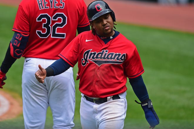 Cleveland Indians' Jose Ramirez reacts after scoring a run on a RBI single by Carlos Santana during the sixth inning of a baseball game against the Milwaukee Brewers, Sunday, Sept. 6, 2020, in Cleveland. (AP Photo/David Dermer)