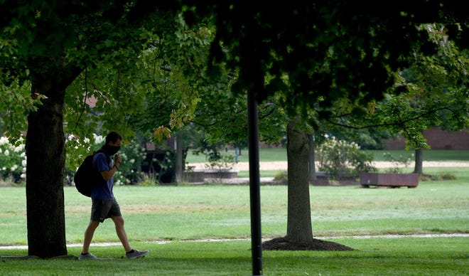A student walks to class Thursday on the campus of University of Mount Union in Alliance.