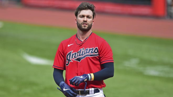 Cleveland Indians' Tyler Naquin (30) reacts after striking out during the sixth inning of a baseball game against the Milwaukee Brewers, Sunday, Sept. 6, 2020, in Cleveland. The Indians won 4-1.