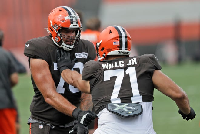 Browns offensive tackles Jedrick Wills Jr., right, and Jack Conklin work on a drill during practice at  training camp facility on Aug. 27.