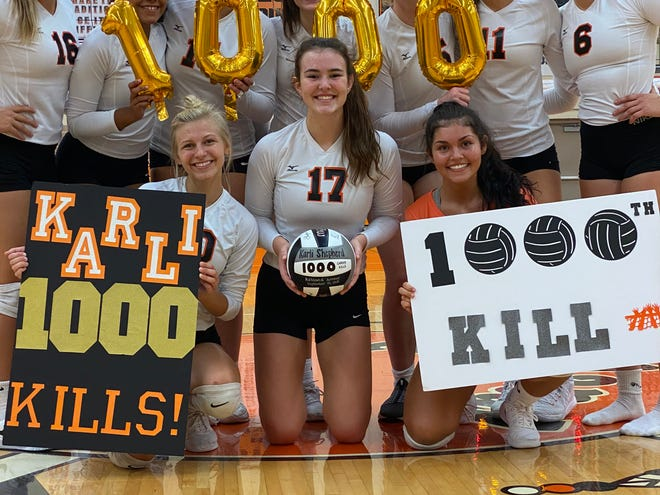 Karli Shepherd, a senior at Ashland High School, hit her 1,000th career kill Thursday against Mansfield Senior. Shepherd (middle on the ground) is pictured with her teammates.