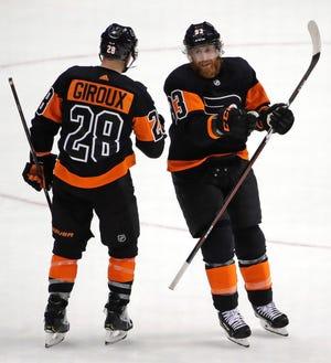The Flyers' Claude Giroux, left, and Jake Voracek celebrate a goal by Voracek.