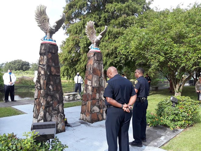 Houma Police Chief Dana Coleman (at left) pays respects Friday during the 19th anniversary of the Sept. 11, 2001, terror attacks.