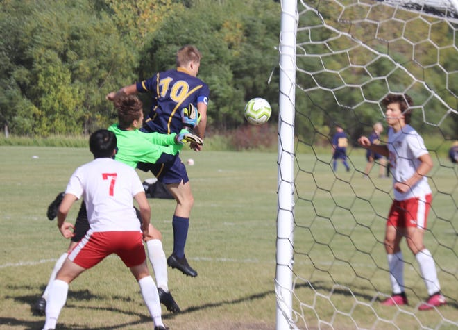 Noah Kiel scores on a header in Crookston's 3-0 win over Hillcrest Lutheran Academy on Thursday. Kiel scored all three of the Pirates' goals, earning his second career hat trick.