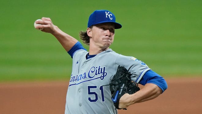 Kansas City Royals starting pitcher Brady Singer delivers in the seventh inning of Thursday's game against the Cleveland Indians at Progressive Field in Cleveland. (Tony Dejak / AP)