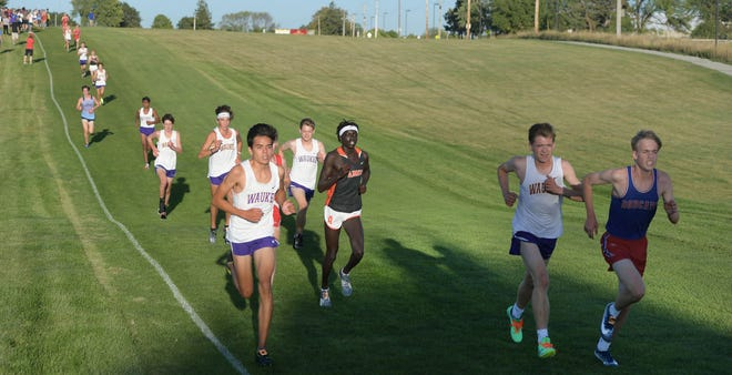 Waukee boys cross country team runs during the boys 5K race in the Ames-Schmatlz Cross Country Invitational at Iowa State University Cross Country  Course Thursday, Sept. 3, 2020, in Ames.