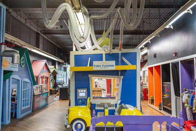 The First Farmers exhibit at aMuse'um mimics a real-life bank teller drive-thru window, including a child-size car, a wind-tunnel system for transferring 'money' and a bank teller counter. (Courtesy photo)