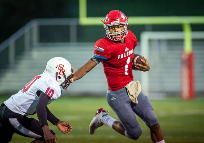Van Horn quarterback Sean Mitchell sheds a Kansas City Southeast defender for a big run in the Falcons' 55-13 win Thursday.
