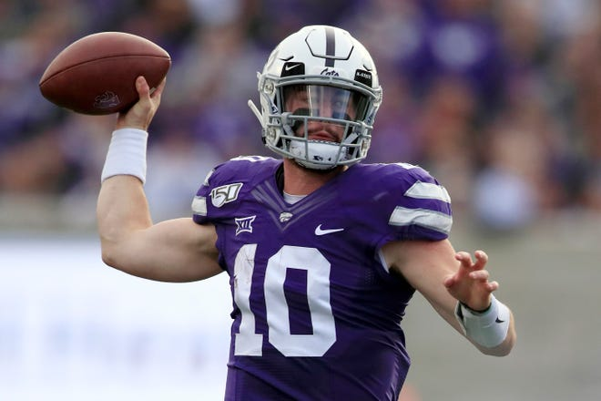 Kansas State quarterback and Fort Osage graduate Skylar Thompson passes to a teammate during the first half against West Virginia in Manhattan, Kan., in November 2019. Thompson is back to direct the offense heading into Saturday's season opener against Arkansas State.