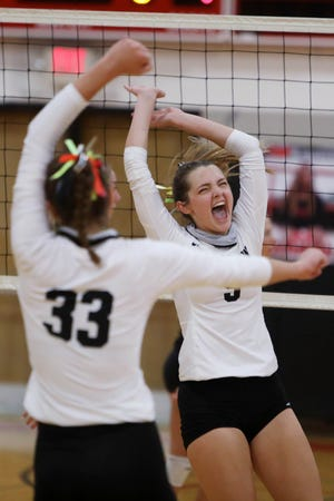 New London High School's Sofie Reighard (9) celebrates a point with teammate Marah Hartrick (33) during their match against Fort Madison High School,  Thursday Sept. 10, 2020 at Fort Madison.
