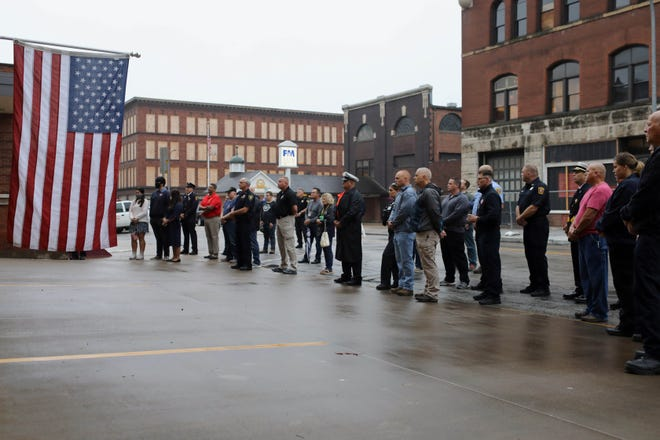 Attendees listen as Burlington Battalion Chief Bruce Workman gives the keynote address during a virtual 9/11 Remembrance Ceremony hosted by the Burlington Fire Department which was live-streamed on the department's Facebook page Friday at the Central Fire Station in Burlington.