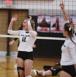 New London High School's Paris Wilka (12) celebrates a point during their match against Fort Madison High School Thursday at Fort Madison. Wilka is back on the court after missing her entire sophomore year with knee surgery.