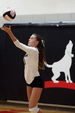 New London High School's Natalie Burden (19) serves the ball during their match against Fort Madison High School, Thursday Sept. 10, 2020 at Fort Madison.
