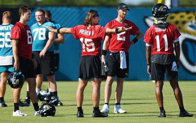 Jaguars quarterbacks #6, Jake Luton, #15, Gardner Minshew II, #2, Mike Glennon on the field at the start of Thursday morning's practice session. Bob Self/Times-Union
