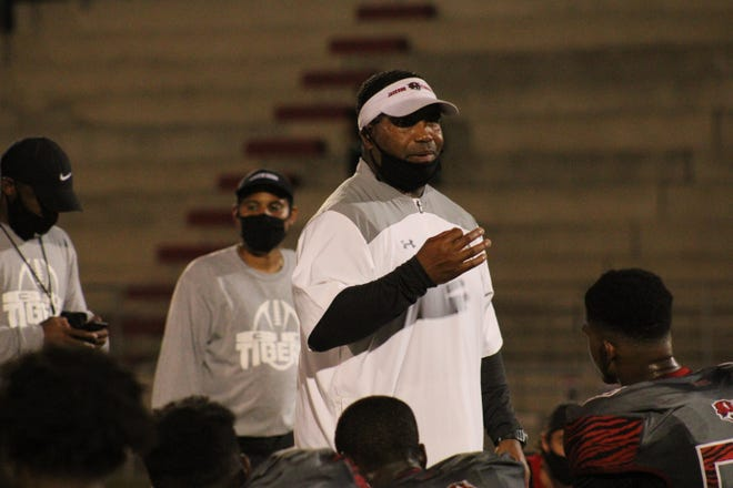 Jackson head coach Christopher Foy speaks to his team after defeating Englewood 36-7 in the high school football season opener on September 10, 2020. [Clayton Freeman/Florida Times-Union]