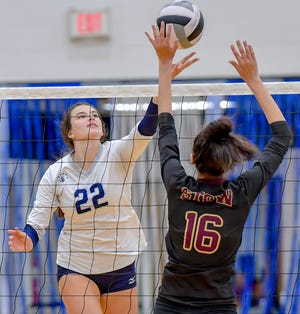 "Hudson senior Brooke  Ramlow tips the ball over Stow-Munroe Falls' Emily Dittman during the Explorers 25-17, 25-15, 25-22 win over the Bulldogs Sept. 4 at Ray ""Buck"" Hyser Gymnasium. Rawlow led all players with 11 kills in the match"