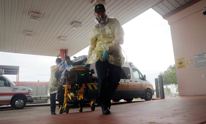 In this July 28 file photo, a man arrives at Starr County Memorial Hospital in Rio Grande City, Texas. The number of daily U.S. deaths from the coronavirus is declining again after peaking in early August, but scientists are warning that a new bout with the disease this fall could claim more lives.