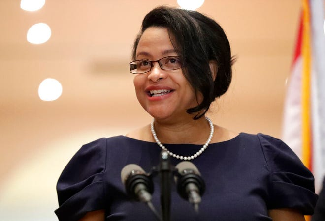 In this May 26 file photo, Renatha Francis smiles as she speaks at a news conference in Miami. Francis was deemed constitutionally ineligible to serve in the Florida Supreme Court , the state's high court said in an order issued Friday.
