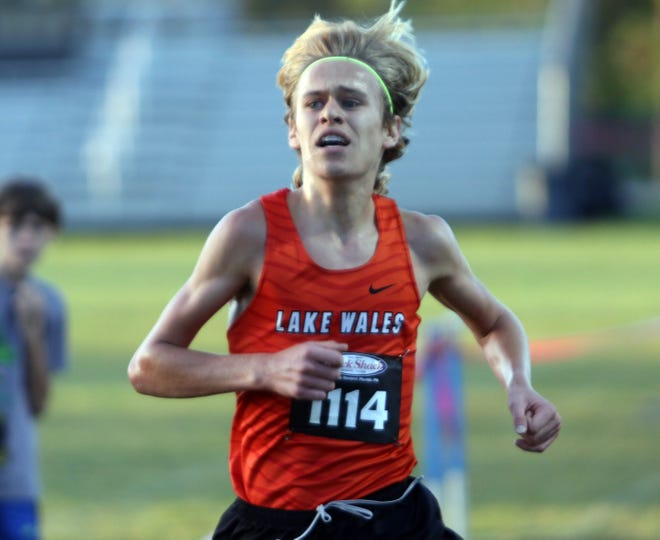 Lake Wales junior Mac Updike runs to a second place finish in the boys race of the Polk County Championshps on Saturday at Lake Region High School.