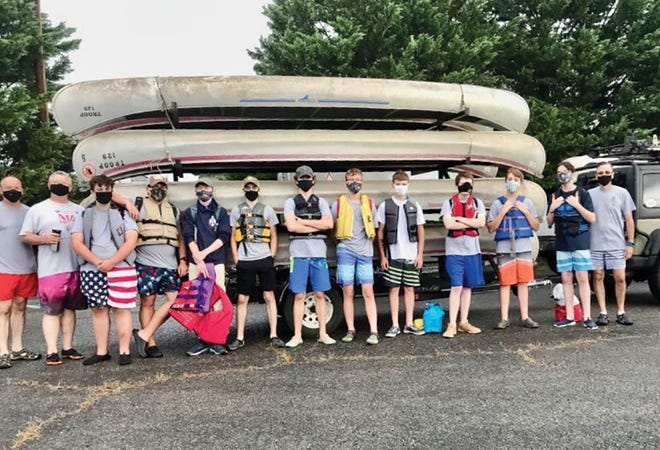 Boy Scout Troop 129, from Oak Ridge, prepared to embark on a five-mile canoe trip from Hickory Creek Park to Melton Hill Dam Campground. Everyone was excited to be back together and enjoying the outdoors. Pictured are James Shell, Assistant Scoutmaster; from left, Dean Williams, Assistant Scoutmaster; Joey Zanoni; Johnny Clark; Kaleb Sluss; Charlie Shell; Henry Coleman; David Bickford; Edward Enos; James Myers; Andrew Frost; Thad Jones; and Matt Frost, Scoutmaster. Not pictured are Jesse and Katy McCallon, assistant scoutmasters.