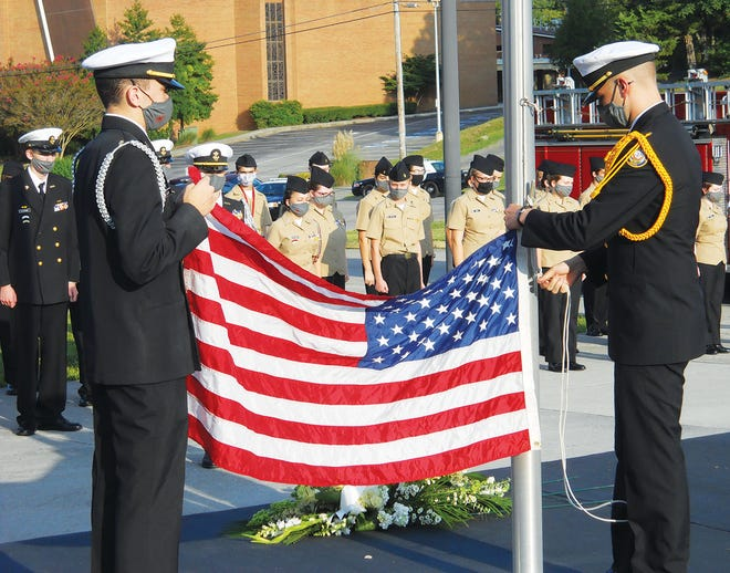 Members of the Naval Junior Reserve Officers Training Corps (NJROTC) program at Oak Ridge High School participate in a flag-raising ceremony at the start of the Sept. 11 remembrance on Friday morning, 19 years after the attacks on the United States.