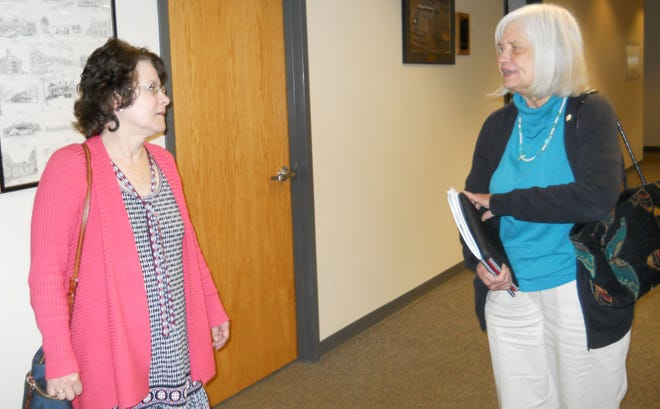 Shira McWaters, left, talks to City Council member Ellen Smith after a City Council meeting earlier this year.