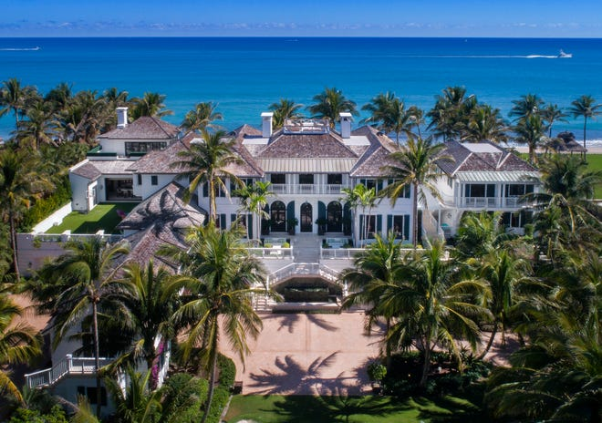 After buying this oceanfront mansion built by Tiger Woods' ex-wife or a recorded $28.6 million in early September, billionaire Russell Weiner has flipped it, courthouse records suggest. Weiner sold the mansion in northern Palm Beach County for a recorded $41.77 million along with a smaller house across the street for a recorded $6.42 million. [Photo courtesy Sotheby's International Realty]