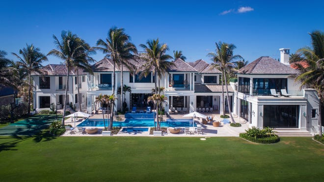 Billionaire Robert F. Smith last month reportedly bought this oceanfront at 12520 Seminole Beach Road in Seminole Landing, plus an adjacent house, for a combined $48 million, according to the recorded prices. Billionaire Russell Weiner flipped the houses within weeks after buying them for about $33 million from Elin Nordegren, ex-wife of golfer Tiger Woods. [Photo by Lifestyle Production Group, courtesy Sotheby's International Realty]