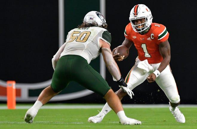 Miami (Fla.) quarterback D'Eriq King runs into Alabama-Birmingham linebacker Noah Wilder during the first quarter of Thursday's  game.