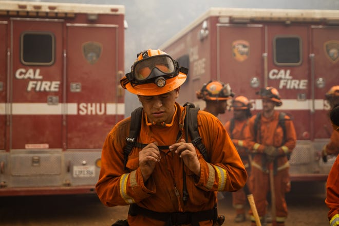 Inmate firefighters with the Sugar Pine Conservation Crew head out to battle the Bear Fire, part of the North Complex Fire, on Thursday near Oroville, Calif.