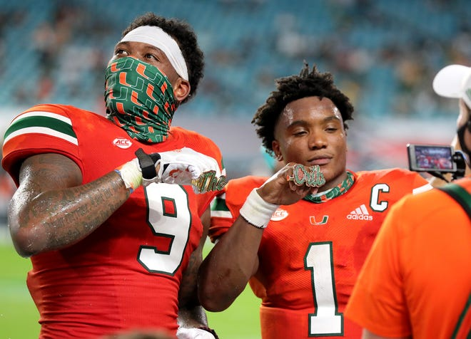 Miami tight end Brevin Jordan (9) and quarterback D'Eriq King (1) display their touchdown rings in the third quarter of teh Hurricanes' victory over UAB at Hard Rock Stadium.