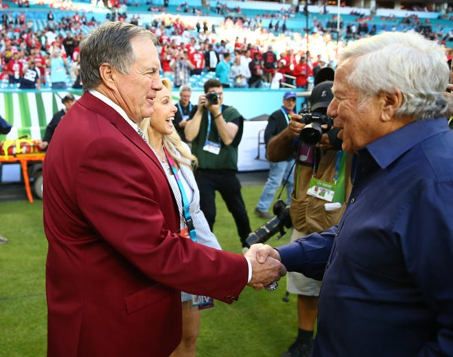 Patriots coach Bill Belichick (left) and owner Robert Kraft meet before the Super Bowl last February at Hard Rock Stadium. New England is the NFL's second most valuable franchise.