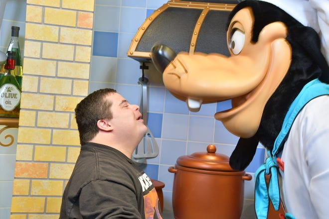 Joshua Marr, 29 — pictured here with Goofy at his favorite place, Disneyland — is one of three San Joaquin County residents whose photos were chosen to be featured in the National Down Syndrome Society's annual Times Square Video presentation.