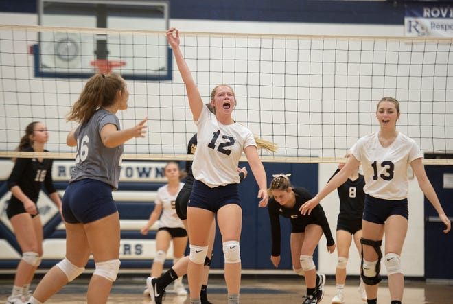 From left, Kylie Kaut, Kasidy Smith and Shaelyn Stefancik celebrate a Rootstown point.